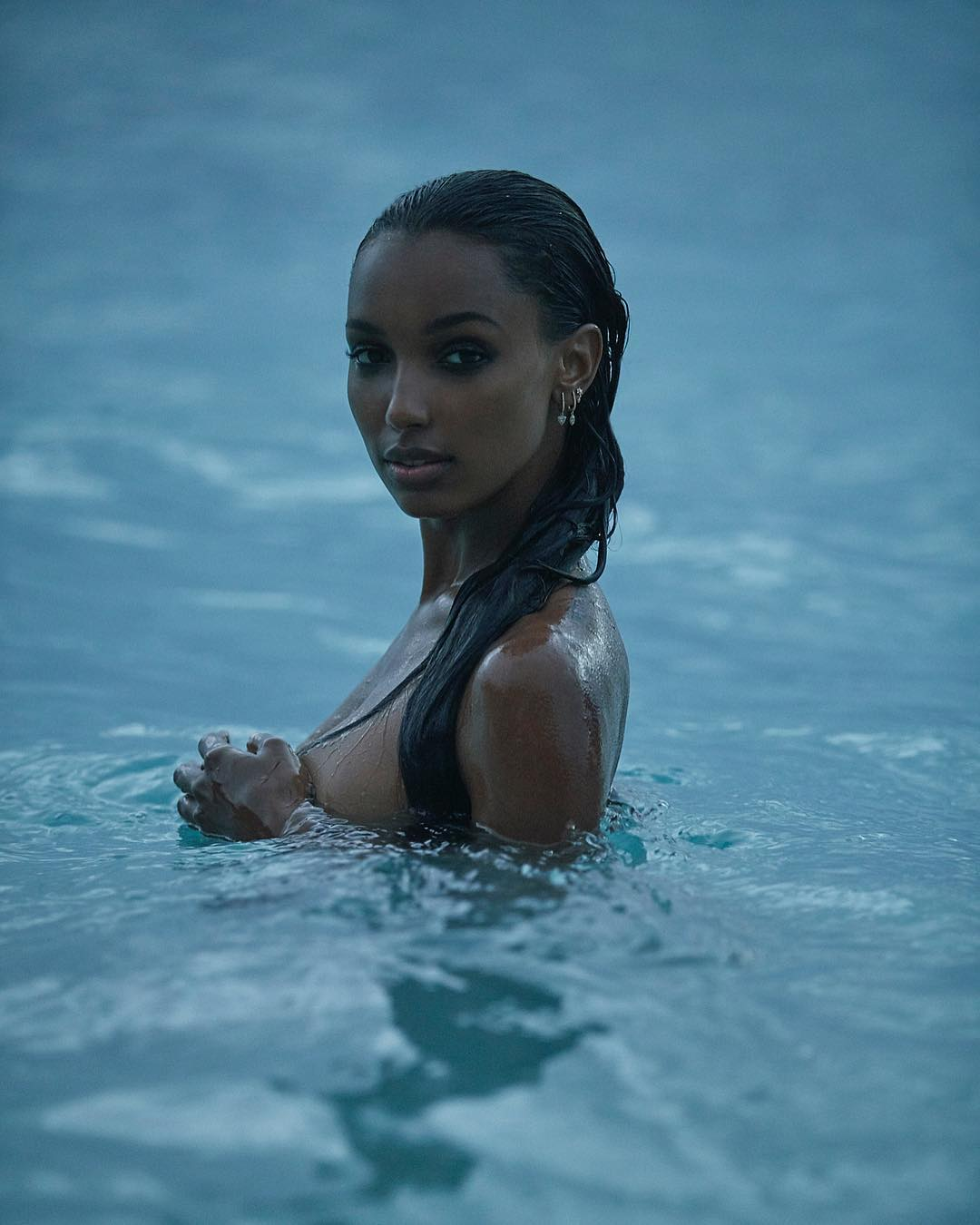 Jasmine Tookes topless in water